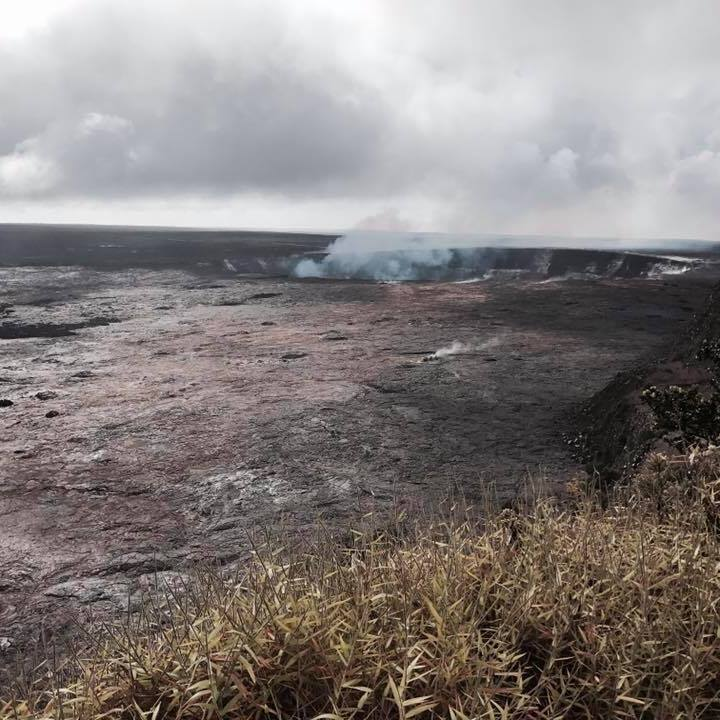 Photo of Halema`uma`u Crater sending up clouds of smoke, Big Island, Hawai`i.